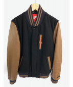 NIKE(ナイキ)の古着「袖革スタジャン」|ブラック×ブラウン