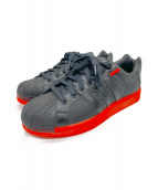 adidas(アディダス)の古着「レザースニーカー」|ブラック×オレンジ