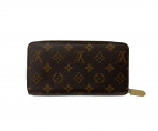 LOUIS VUITTON(ルイヴィトン)の古着「ジッピー・ウォレット」 ブラウン×ピンク
