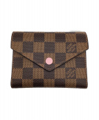 LOUIS VUITTON(ルイヴィトン)の古着「2つ折り財布」 ブラウン×ピンク