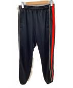 GUCCI(グッチ)の古着「リラパッチ付ストライプジョギングパンツ」|ブラック×レッド