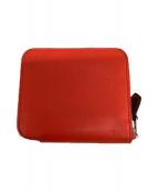 ()の古着「ラウンドファスナー財布」|オレンジ