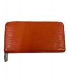 ()の古着「ラウンドファスナー長財布」 オレンジ