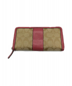 COACH(コーチ)の古着「ラウンドファスナー財布」|ベージュ×ピンク