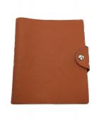 HERMES(エルメス)の古着「手帳カバー」|オレンジ