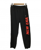 New Era(ニューエラ)の古着「クロスウェアパンツ」|ブラック×ネオンレッド