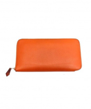 HERMES(エルメス)の古着「ラウンドファスナー長財布」|オレンジ