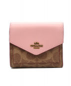 COACH(コーチ)の古着「2つ折り財布」|ピンク×ブラウン
