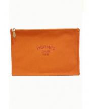HERMES(エルメス)の古着「フラットポーチ」|オレンジ