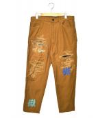 KUON(クオン)の古着「ラバープリントダメージパンツ」|ブラウン