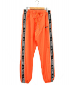 PLEASURES × LMC(プレジャーズ × エルエムシー)の古着「サイドテープパンツ」|オレンジ