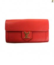 LOUIS VUITTON(ルイ・ヴィトン)の古着「レザーLVロゴフラップ長財布」|レッド