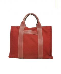 HERMES(エルメス)の古着「キャンバスハンドバッグ」|レッド
