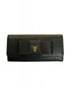 PRADA(プラダ)の古着「サフィアーノレザーリボンフラップ長財布」|NERO(ブラック)