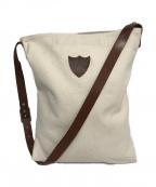 htc(エイチティーシー)の古着「スタッズエゴキャンバスバッグ」|ホワイト
