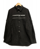 UNDERCOVER(アンダーカバー)の古着「時計仕掛けのオレンジタイプライターシャツ」 ブラック