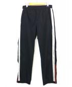 NOMA t.d.(ノーマティーディー)の古着「サイドラインナイロンパンツ」|ブラック
