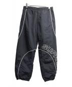 Supreme(シュプリーム)の古着「パイピングトラックパンツ」|ブラック