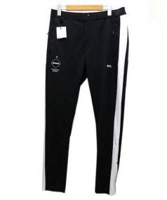 F.C.R.B.(エフシーレアルブリストル)の古着「SIDE LINE PDK PANTS」|ブラック