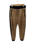 COACH(コーチ)の古着「Signature Varsity Track Pants」|ベージュ
