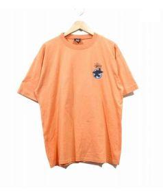 OLD Stussy(オールドステューシー)の古着「ヴィンテージサーフマンTシャツ」 オレンジ