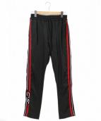 CMMN SWDN(コモン スウェーデン)の古着「サイドライントラックパンツ」|ブラック