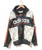 adidas(アディダス)の古着「[古着]ラインスリーブロゴパーカー」|ブラック×オレンジ