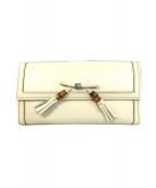()の古着「バンブータッセルリボン2つ折り財布」 ベージュ