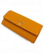 MICHAEL KORS(マイケルコース)の古着「ラージガセットキャリーオール長財布」|オレンジ