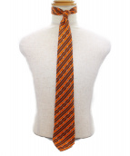 HERMES(エルメス)の古着「蹄鉄柄ネクタイ」 オレンジ