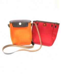 HERMES(エルメス)の古着「レザーキャンバスショルダーバッグ」|レッド×オレンジ