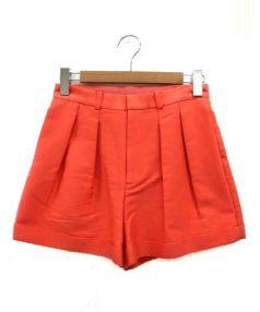 J&M Davidson(ジェイアンドエムデヴィッドソン)の古着「ショートパンツ」 オレンジ