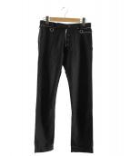 UNDERCOVERISM(アンダーカバーイズム)の古着「ジッププリントパンツ」|ブラック
