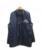 A BATHING APE(エイプ)の古着「プリントコーチジャケット」|ネイビー