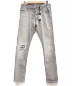 DIESEL(ディーゼル)の古着「ダメージデニムパンツ」|グレー