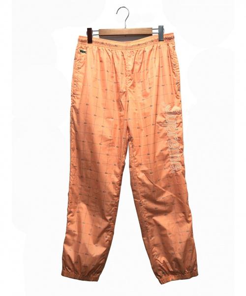 SUPREME×LACOSTE(シュプリーム × ラコステ)SUPREME×LACOSTE (シュプリーム × ラコステ) リフェクティブグリッド ナイロントラックパンツ ピーチ サイズ:M 18SS Reflective Grid Nylon Track Pantの古着・服飾アイテム