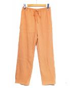 FRAMeWORK(フレームワーク)の古着「製品染め楊柳リラックスパンツ」 オレンジ