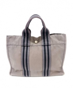 HERMES(エルメス)の古着「キャンバスハンドバッグ」|グレー