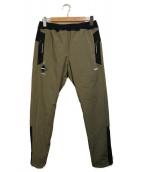 F.C.R.B.(エフシーアールビー)の古着「LYCRA TRACK PANTS」|カーキ×ブラック