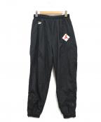 NIKE × patta(ナイキ × パタ)の古着「ナイロンパンツ」|ブラック