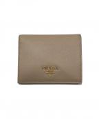 PRADA()の古着「2つ折り財布」 ベージュ