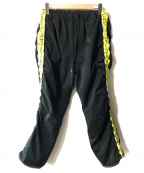 SASQUATCHfabrix.(サスクワッチファブリックス)の古着「WARM-UP PANTS」|ブラック×イエロー