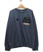 uniform experiment(ユニフォームエクスペリメント)の古着「ロゴワッペンクルーネックスウェット」|グレー