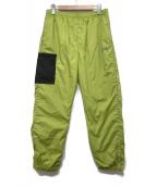 stussy(ステューシー)の古着「トラックパンツ」|黄緑