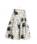 Jocomomola(ホコモモラ)の古着「フラワープリントスカート」|ブラック×ホワイト