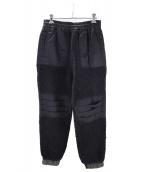 UNDERCOVER(アンダーカバー)の古着「ボアトラックパンツ」|ブラック