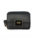 ANYA HINDMARCH(アニヤハインドマーチ)の古着「Enamel Lock Compact Wallet」 ブラック