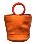 SIMON MILLER(サイモンミラー)の古着「ラウンドハンドルレザーミニバッグ」|オレンジ