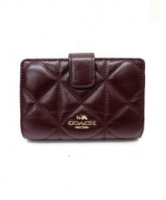 COACH(コーチ)の古着「キルテッド2つ折り財布」|ブラウン
