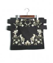GIVENCHY(ジバンシー)の古着「フラワープリントラップスカート」|ブラック